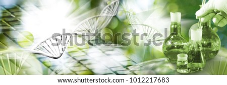 abstract biotechnological imagelaboratory glassware in hand on a green background Royalty-Free Stock Photo #1012217683