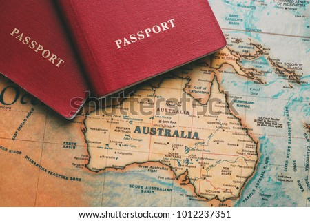 Two passports on map. Travel to Australia Royalty-Free Stock Photo #1012237351