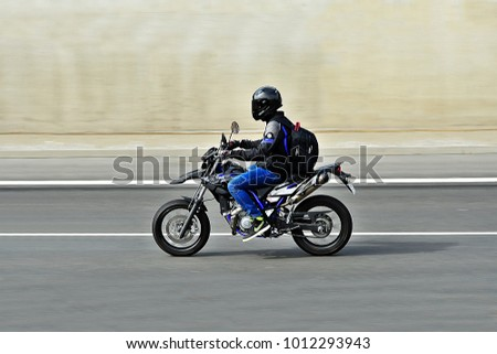 FRANKFURT,GERMANY-APRIL 16,2015: unknown Rider on the freeway. #1012293943