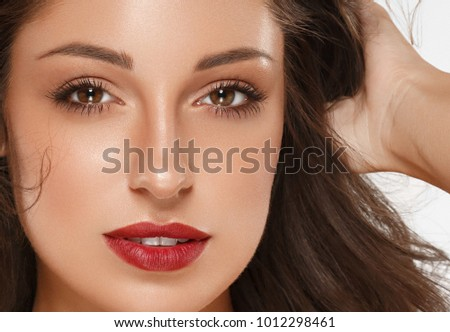 Beautiful Woman Skin Tanned Red Lips Healthy Beauty Skin Smile. Spa Beautiful Model Girl Cute Face over color background. #1012298461