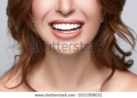 Healthy white smile close up. Beauty woman with perfect smile, lips and teeth. Beautiful Model Girl with white teeth and perfect skin. Teeth whitening.  #1012308031