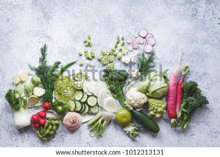 Plant based raw food seasonal vegetables background. Winter vegetarian, vegan food cooking ingredients. Flat-lay, top view Royalty-Free Stock Photo #1012313131