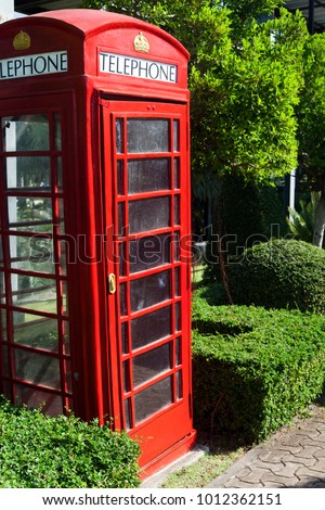 The red public callbox costs among tropical greens #1012362151