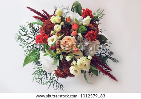 Eustoma, a wedding bouquet, flowers in hands, a bouquet on a white background, a diverse design bouquet, a decorative composition of flowers and coniferous branches #1012579183
