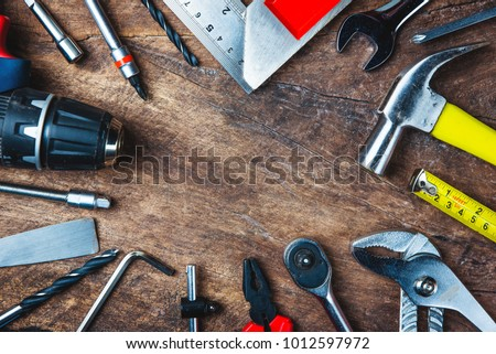 Different construction tools with Hand tools for home renovation on wooden board maintenance and reparing concept. Royalty-Free Stock Photo #1012597972