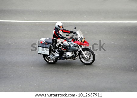 FRANKFURT,GERMANY-JAPRIL 16,2015: unknown Rider on the freeway. #1012637911