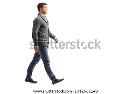 Full length profile shot of a young man walking isolated on white background #1012661140