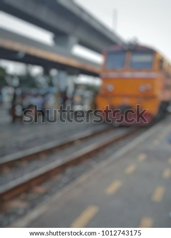 A blur backgeound of the traing is approaching at railway  #1012743175