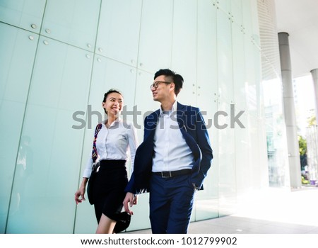 Asian business people discussing while walking #1012799902