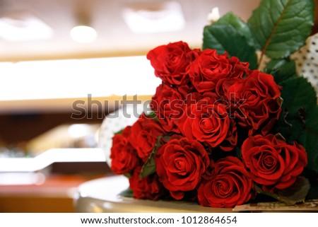 red roses bouquet elegant lights #1012864654