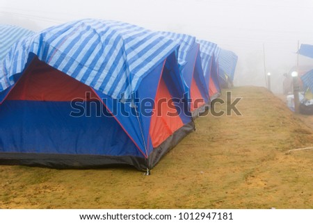 tourist tent in mist and fog. Travel tent in the morning with fog. #1012947181