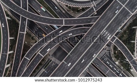 Aerial view of highway and overpass in city on a cloudy day #1012975243