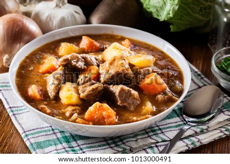 Irish stew made with beef, potatoes, carrots and herbs. Traditional  St patrick's day dish #1013000491