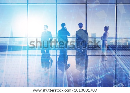 Meeting and research concept. Businesspeople in abstract iterior with city view. Double exposure #1013001709