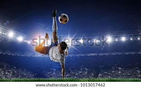 Soccer player at stadium. Mixed media Royalty-Free Stock Photo #1013017462