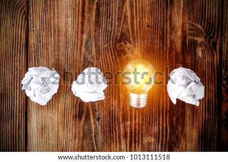 Idea background with bulb and paper on wooden brown desk top.  #1013111518