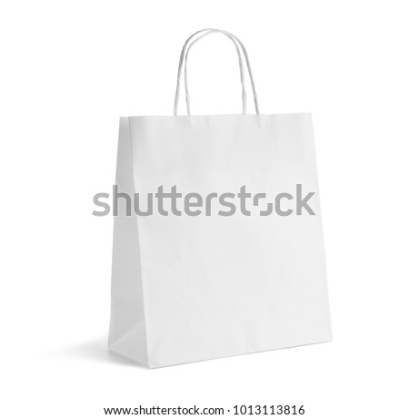 Paper bag on white background. Mockup for design Royalty-Free Stock Photo #1013113816