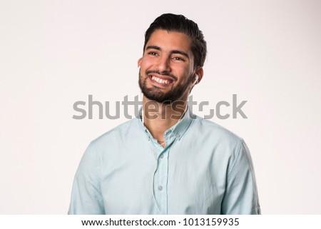 arabic young man happy smiling using earphones #1013159935