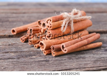 Aromatic cinnamon sticks on a wooden background #1013205241