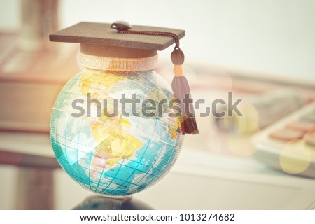 Graduated study abroad international Conceptual, Graduation hat on top Earth globe model map with Radar background. Congratulations to graduates, Studies lead to success in world wide. Back to School Royalty-Free Stock Photo #1013274682