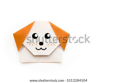 Origami for kids : dog with white folded paper and brown ear on white background isolated. Copy space for text.Top view, flat lay.Easy to use for card. #1013284504