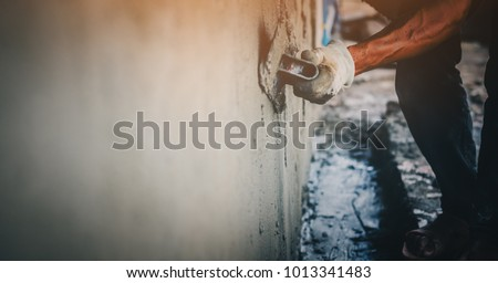 Blurred mason rural thailand Plastering concrete to build wall background industrial worker with plastering tools renovating house concept quality, professional of skilled labor construction industry #1013341483