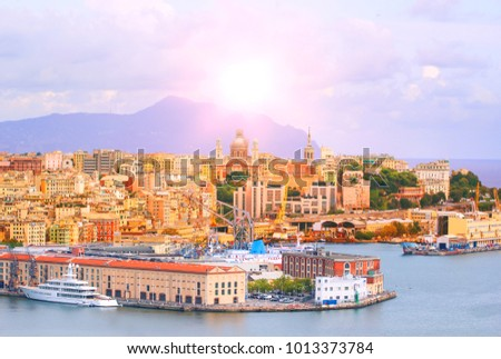 High angle view of Genoa (Genova) city with sea view and yachts under the bright sun in natural background. Royalty-Free Stock Photo #1013373784