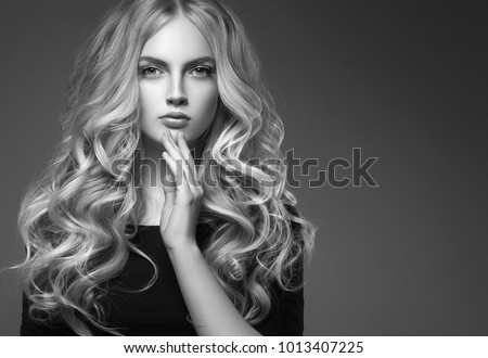 Female hairstyle long and cuerly black and white portrait over gray background #1013407225