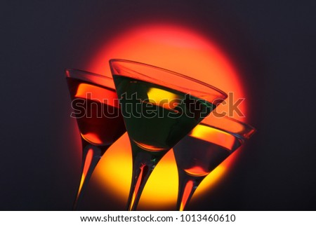 Three  cocktails, Woo woo , Appletini and Vodka martini, backlit with creative gels for effect. #1013460610