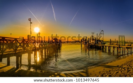 Vintage wooden pier at beach sunset, Lido di Jesolo, Venice, Italy #1013497645