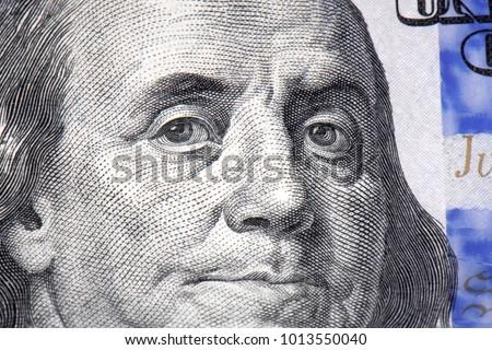macro micro of 100 dollar bill ben franklin head eyes looking offset #1013550040
