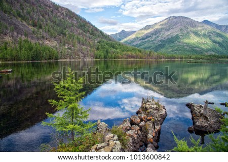 Wonderful lake wide panorama. Scenic summer landscape, mountains and blue cloudy sky at background. Eastern Sayan, Buryatia, Russia. #1013600842