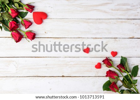 Red roses and hearts on old white wood table/Valentines day background with copy space  #1013713591