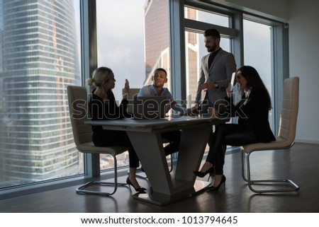 Business people working in an office on a background of panoramic windows. #1013794645