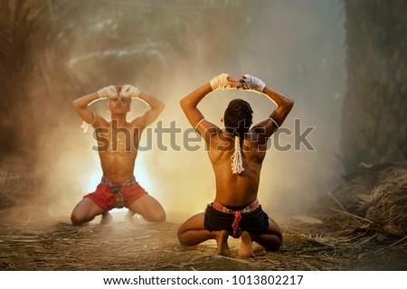 Muay thai, Thai Boxer training in sunset background,Thai boxer culture,Thailand Royalty-Free Stock Photo #1013802217