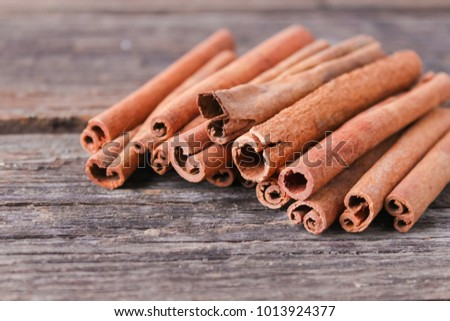 Aromatic cinnamon sticks on a wooden background #1013924377