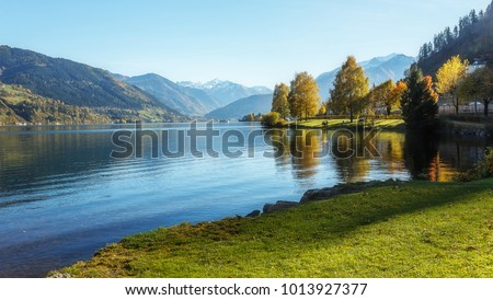 Amazing landscape of alpine lake with crystal clear green water and Perfect blue sky. Panoramic view of beautiful mountain landscape in Alps with Zeller Lake in Zell am See, Salzburger Land, Austria #1013927377