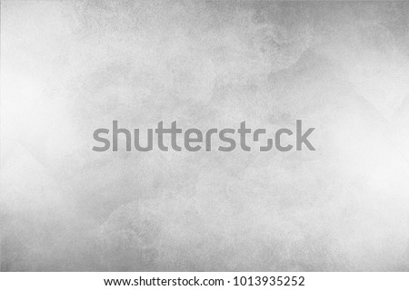 Paint (50%), texture (50%). Texture of the painted surface of a smooth rough wall. Relief plane. Balanced gray color. Light reflex. White Design Background. Artistic plaster. Rastered image. Royalty-Free Stock Photo #1013935252