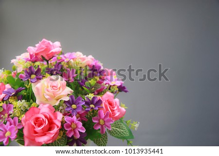Pink rose bouquet isolated on gray background, soft focus. #1013935441