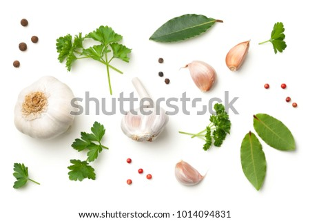 Garlic, bay leaves, parsley, allspice and pepper isolated on white background. Top view  #1014094831