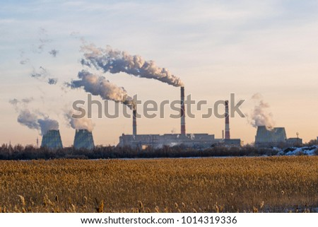 The factory emits dirty smoke from the pipes #1014319336