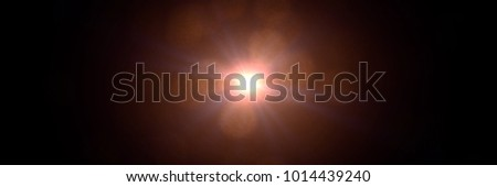 intense golden lens flare effect overlay texture banner with bokeh effect and light streak in front of a black background #1014439240