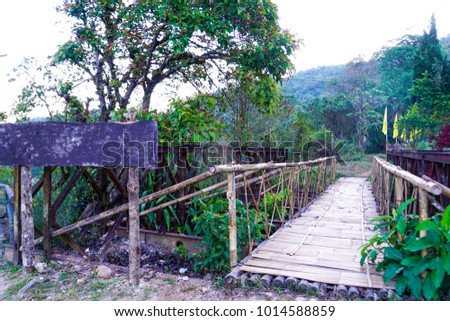 Wooden bridge made of bamboo. In the old mining village community. #1014588859