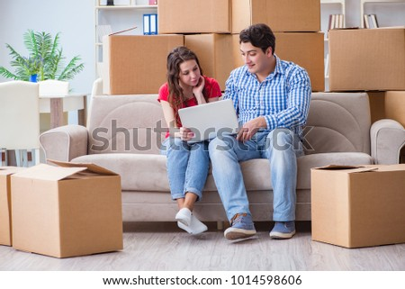 Young pair moving in to new house with boxes #1014598606