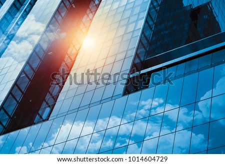 Skyscraper or modern building in the city with cloud and sunlight #1014604729