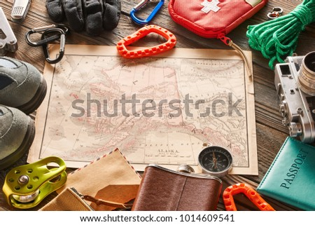 Travel items for hiking tourism still life over wooden background #1014609541