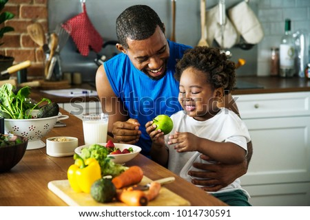 Dad and son cooking together Royalty-Free Stock Photo #1014730591
