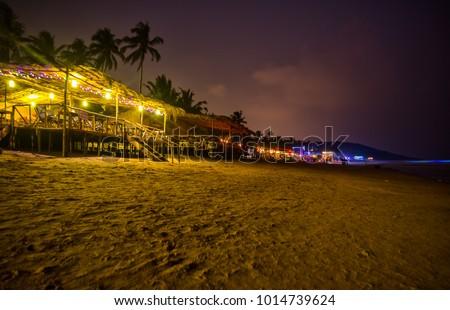 Anjuna Beach in Goa India - Beach club at night #1014739624