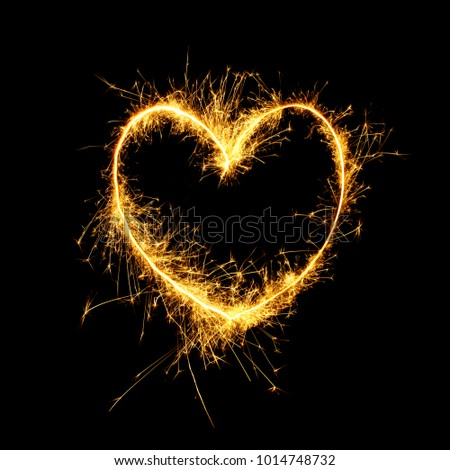 Beautiful Sparkling golden heart isolated on black background. Glowing Outline of a heart shape to overlay on the textures in the design Holiday greeting card, background for Valentine's Day, Wedding #1014748732