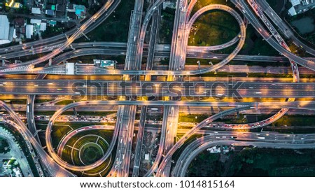Top view over the highway, expressway, motorway at night, Aerial view interchange of a city. #1014815164